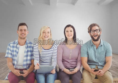 group of people sitting with devices