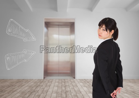 business woman standing against white room