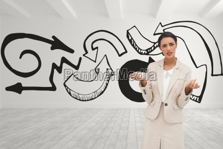 confused business woman standing against white