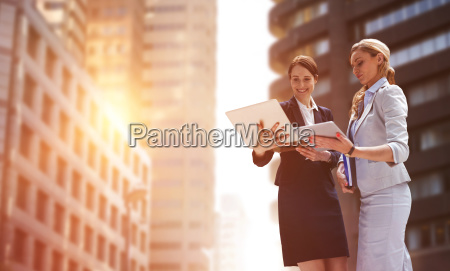 composite image of smiling business women