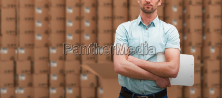 composite image of serious warehouse manager