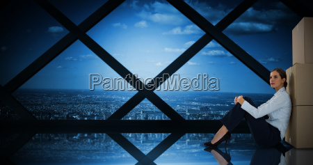 composite image of businesswoman leaning on