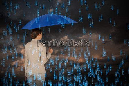 composite image of businesswoman holding blue