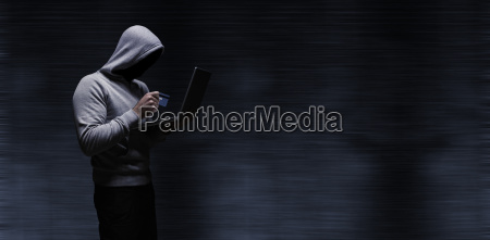 composite image of hacker using laptop