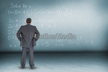 composite image of businessman standing back