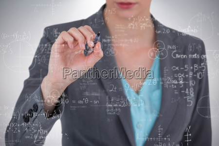 composite image of businesswoman using invisible