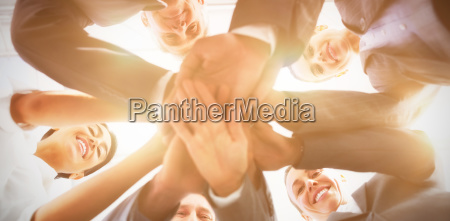 business team standing hands together