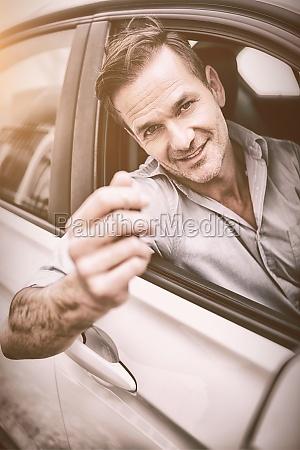 smiling handsome man holding key