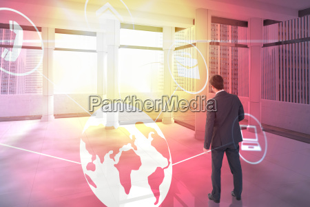 composite image of businessman standing and