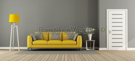 gray living room with yellow sofa