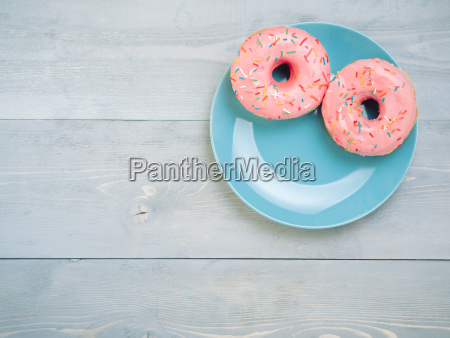 pink donuts on gray wooden background
