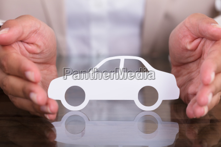 persons hand protecting car cut out