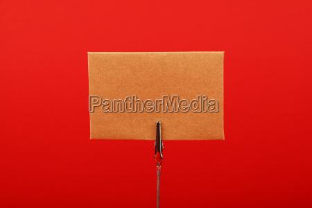 blank brown kraft paper sign over