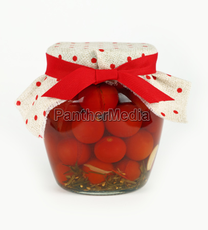 jar of pickled small red cherry