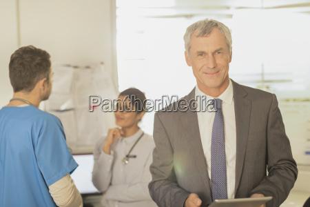 portrait smiling confident hospital administrator using
