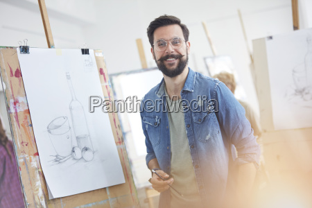 portrait smiling male artist with beard