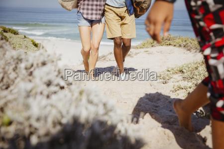 legs of multi ethnic couple walking