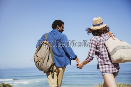 affectionate multi ethnic couple holding hands