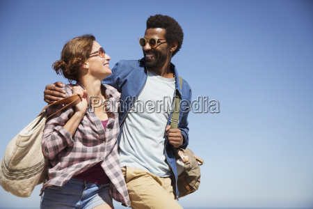 affectionate multi ethnic couple hugging and