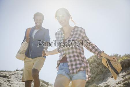 smiling affectionate multi ethnic couple holding