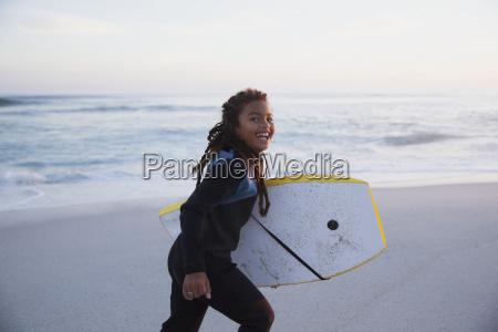 portrait happy pre adolescent girl running
