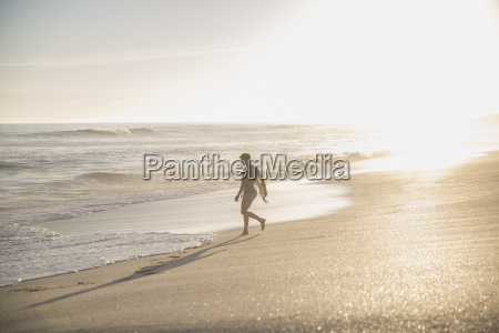 silhouette woman walking on sunny summer