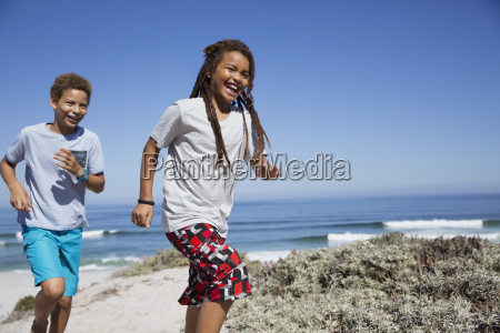 happy brother and sister running on