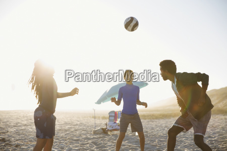 family playing soccer on sunny summer
