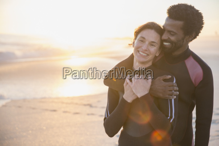 smiling affectionate multi ethnic couple in