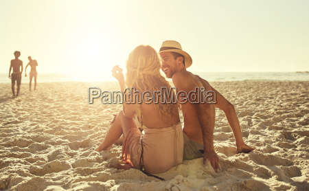 young couple relaxing on sunny summer