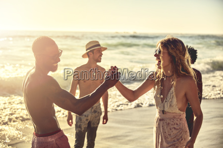 playful young couple high fiving on