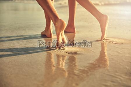 bare feet of women walking on