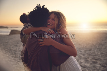 affectionate couple hugging on sunny sunset