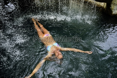 young woman floating in water in