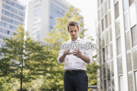 businessman using portable glass device in