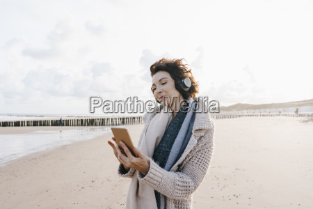 woman on the beach with cell