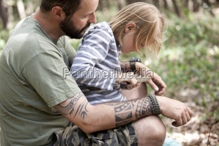 father and daughter carving in the
