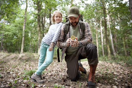 father and daughter with compass in