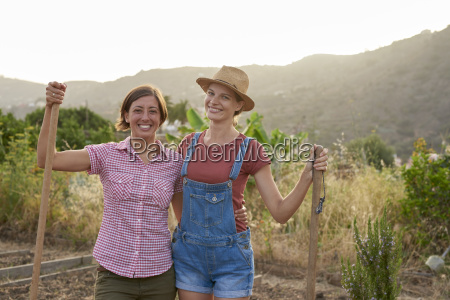 portrait of two happy farmers with