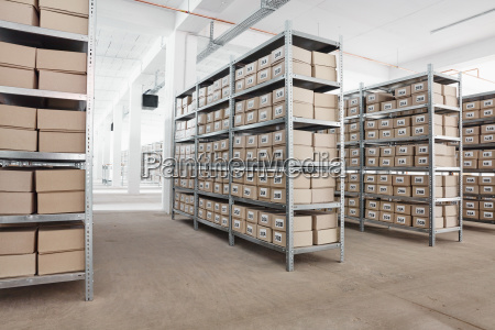 cardboard boxes on shelves in a