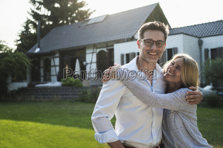 happy couple embracing in the garden