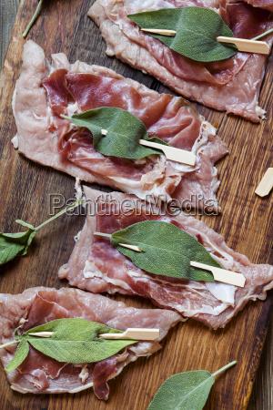 preparation of saltimbocca alla romana