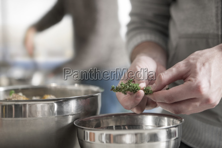 close up of man preparing meal