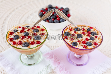 two yogurt dessert with berries almonds