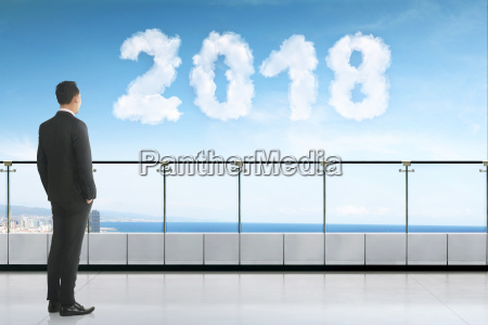 young asian businessman looking cloud with