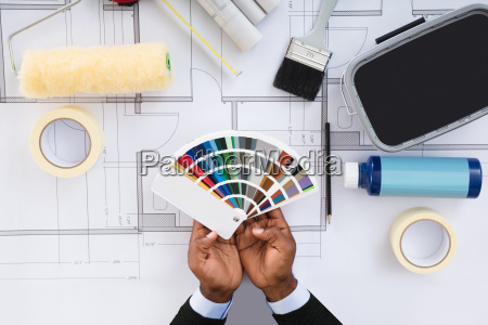 person holding color samples