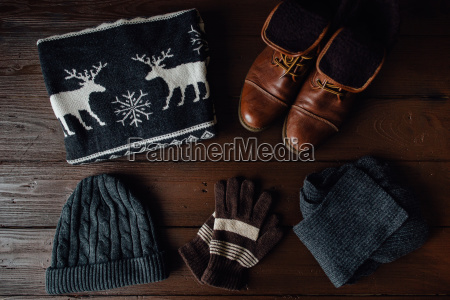 mens winter clothes on a brown