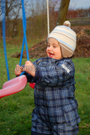toddler with swing