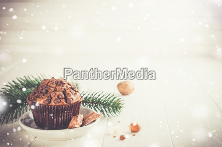 chocolate muffin on white wooden background