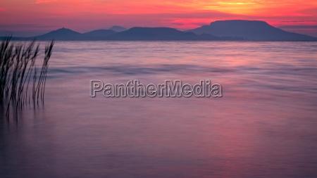 beautiful sunrise over the lake balaton